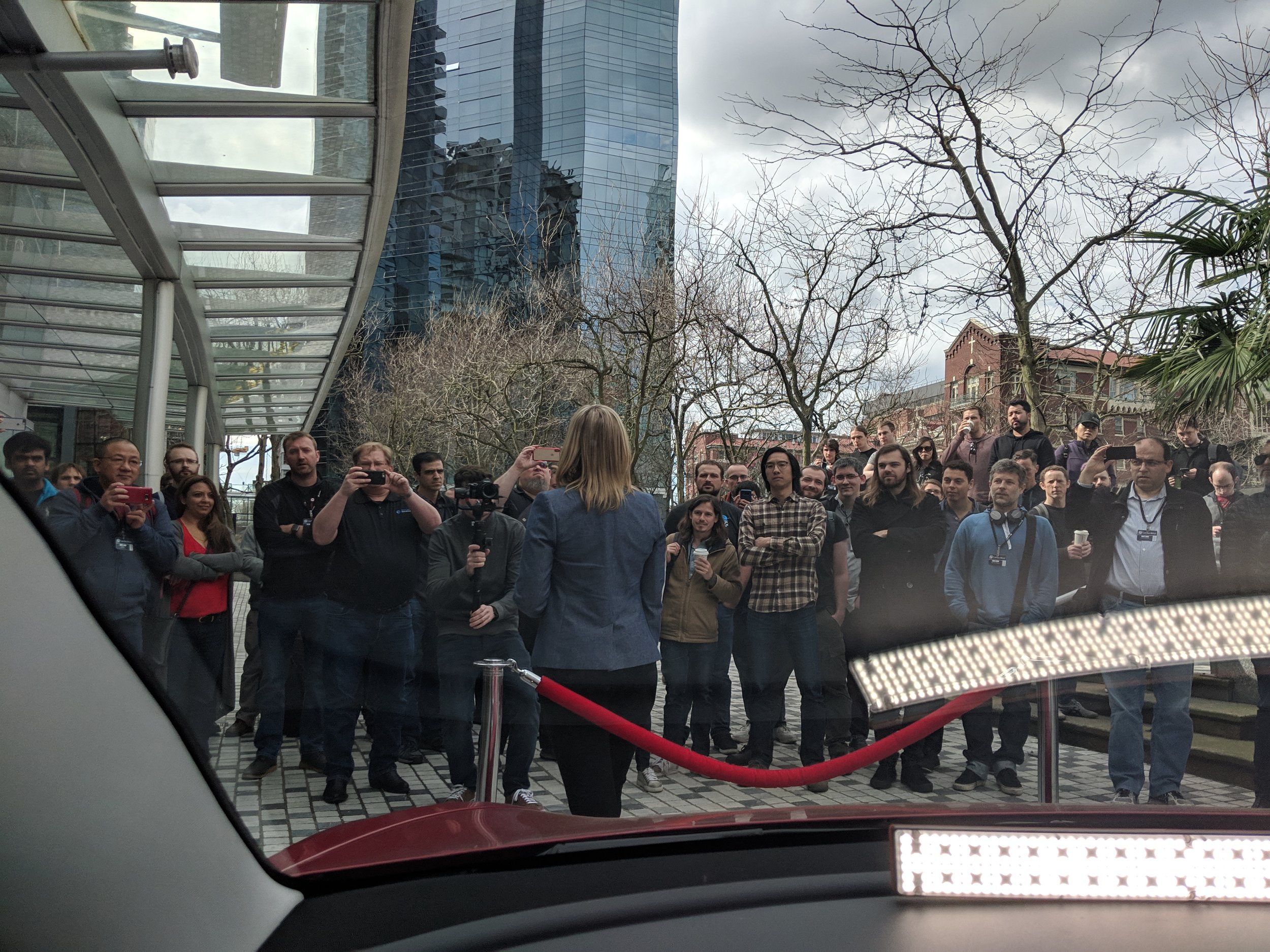 The assembled crowd viewed from within the vehicle