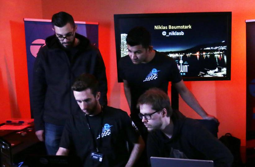Niklas Baumstark (bottom right) demonstrates his Firefox exploit as ZDI analysts observe