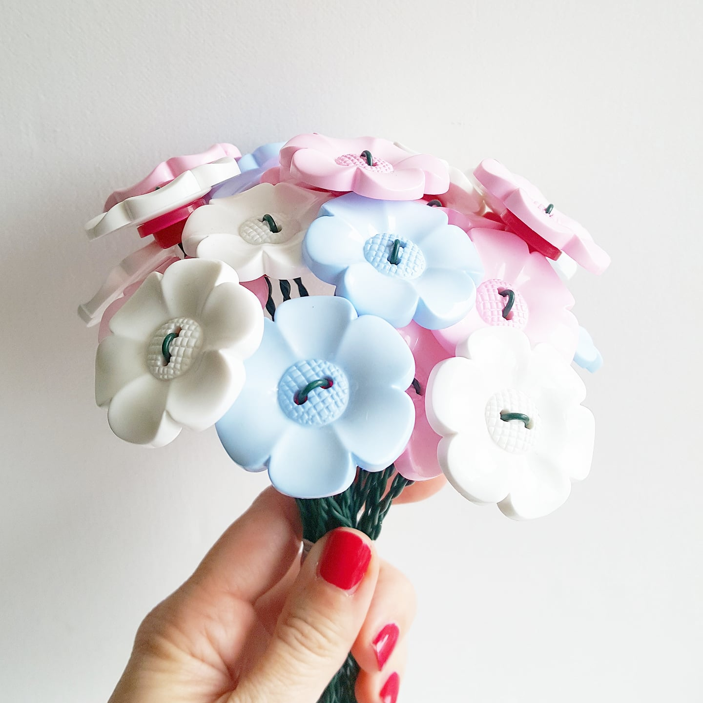 plastic flowers made of buttons