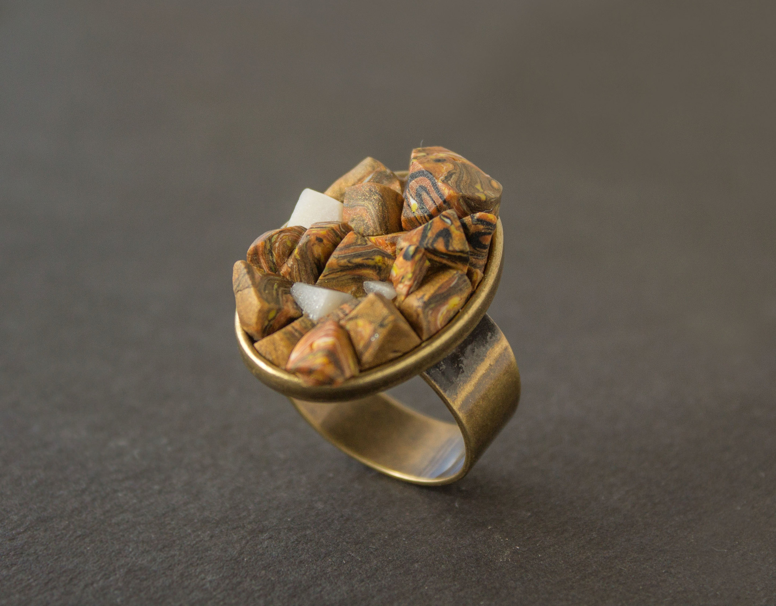 brass ring with yellow stones