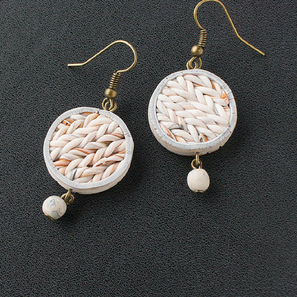 a pair of white earrings with beads