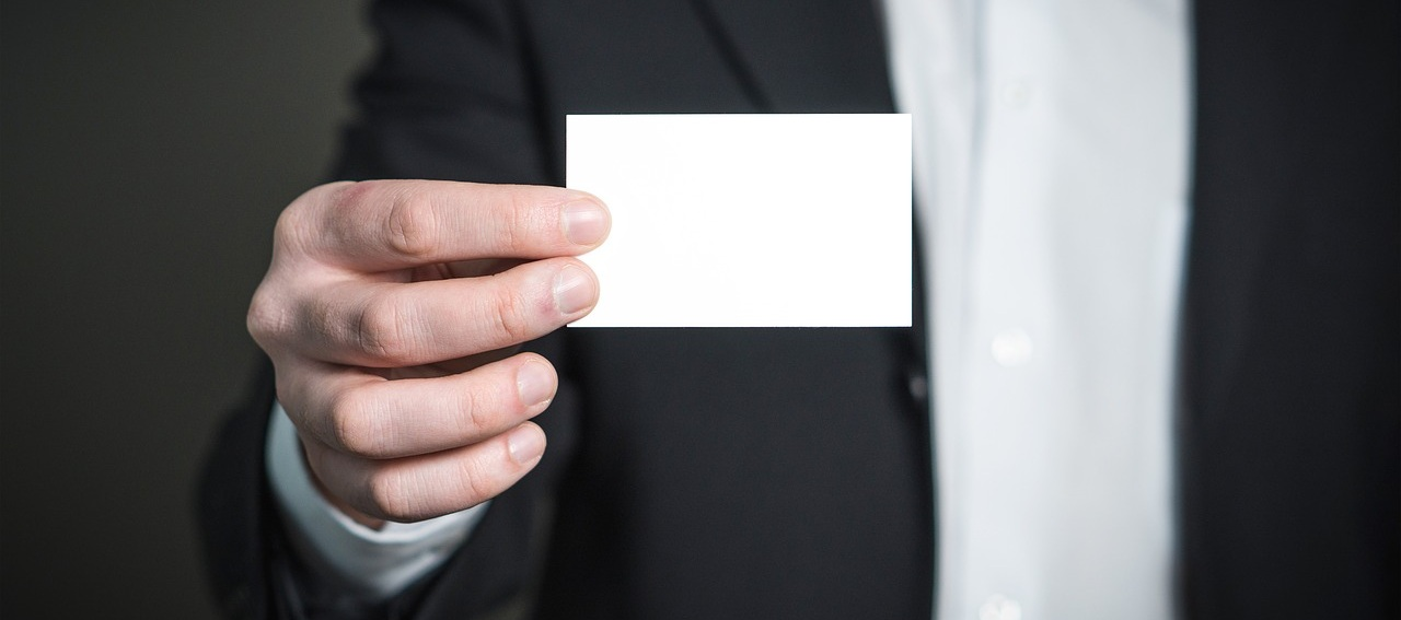 Lawyer in suit holding business card from Pixabay