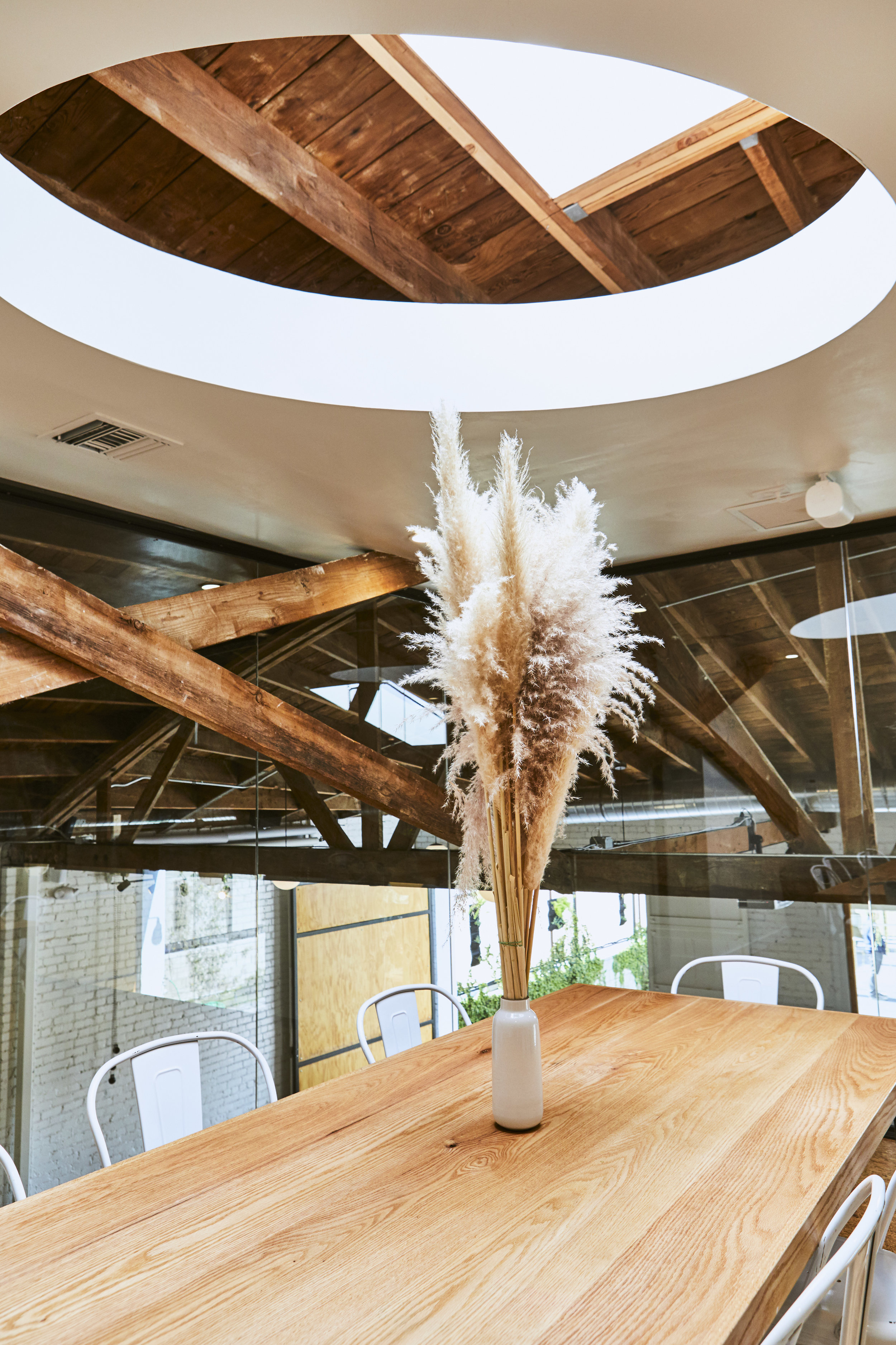 The oval opens up to an oversized skylight. The conference room is full of natural light.