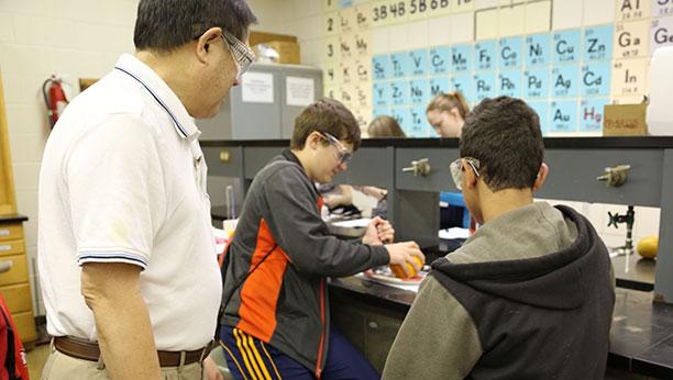 Legendary Chem Professor Don Fujito shows some budding scientists the ropes.
