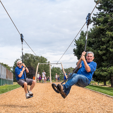 President Kim Carswell and project manager Vice President Allan Calderwood enjoy the zip line