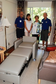 """A new """"sleeper chair"""" is proudly shown at Tsawwassen's KinVillage. The Tsawwassen Boundary Bay Lions Club assisted KinVillage in fundraising efforts to purchase the new chair. This will allow friends and family to stay with their loved ones during sensitive periods. Pictured (from left) are Steve Dane, Secretary of the Lions Club; Bettina Salina, Director of Wellness at KinVillage; Donna Ellis, CEO KinVillage and Kim Carswell, President of the Lions Club"""