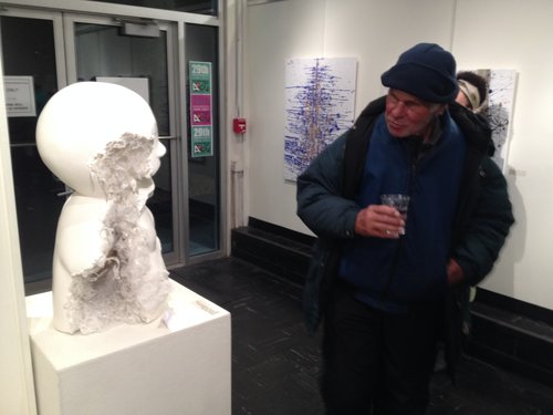 Opening night visitor contemplates a sculpture by Kim Rask.