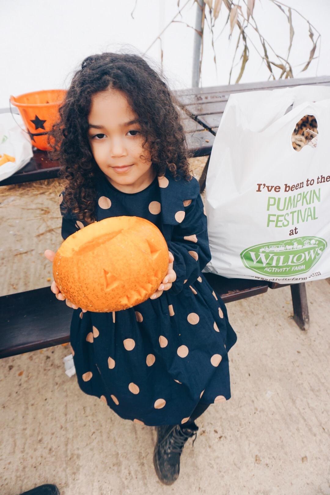 girl with pumpkin.jpg