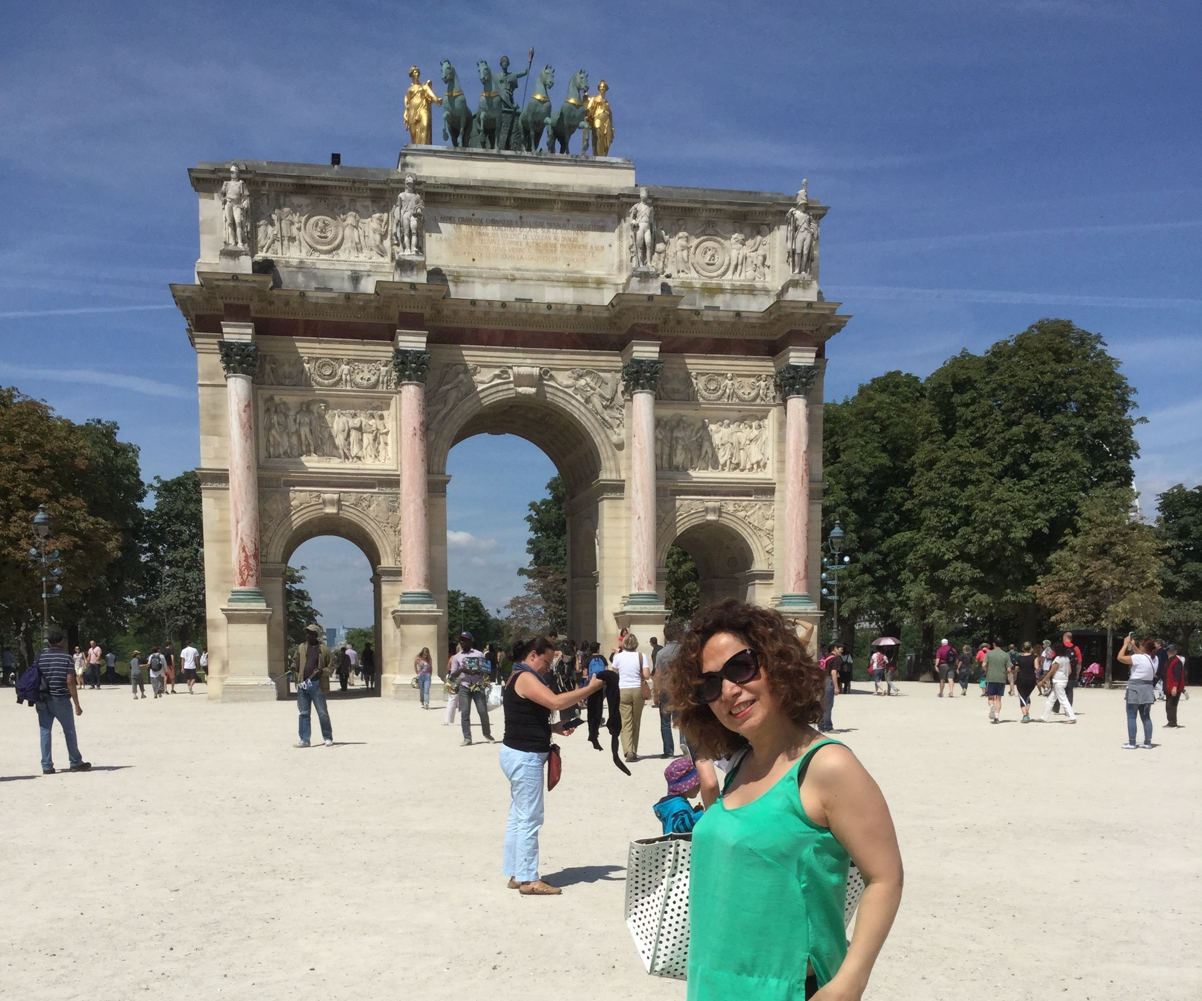 M e in front of  Arc de Triomphe du Carrousel . It was built between 1806 and 1808 to commemorate  Napoleon 's military victories of the previous year.