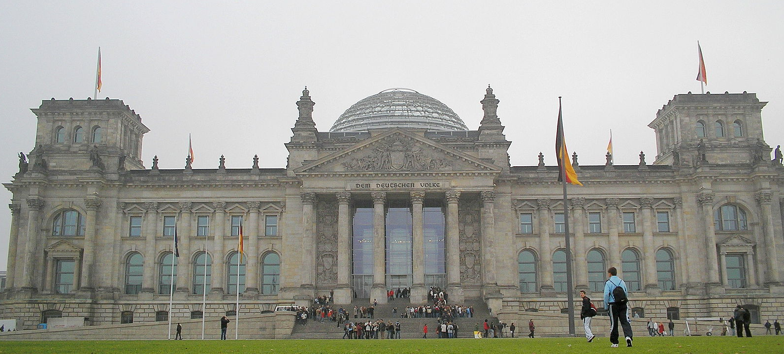 The Reichstag is a historic building that houses the  Bundestag (Federal Diet or German Parliament). Its function as Germany's legislative center since 1871 was interrupted, first by arson in 1933, which seriously damaged it, then by World War II. After the fall of the Berlin Wall and German reunification in 1990, architect Norman Foster oversaw its reconstruction. It required almost total gutting. This iconic structure grabbed headlines in 1995, when it was completely covered in plastic cloth as an art project of Christo and Jeanne-Claude. Upon completion in 1999, the building resumed its function as the home of Germany's  Bundestag . It is the most popular attraction in the country, after the gothic World Heritage Cologne Cathedral. The massive glass dome, which attracts many visitors, was added during this renovation.