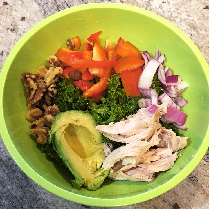 Basic Salad - I use different proteins in my salads, different veggies (both cooked and raw), and different greens as a base. It takes 5 minutes to throw together and is extra satisfying because of the healthy fats.This one has:- raw kale-dressing of olive oil and ACV (apple cider vinegar)-red onion-red pepper-chicken-walnuts-1/2 an avocado