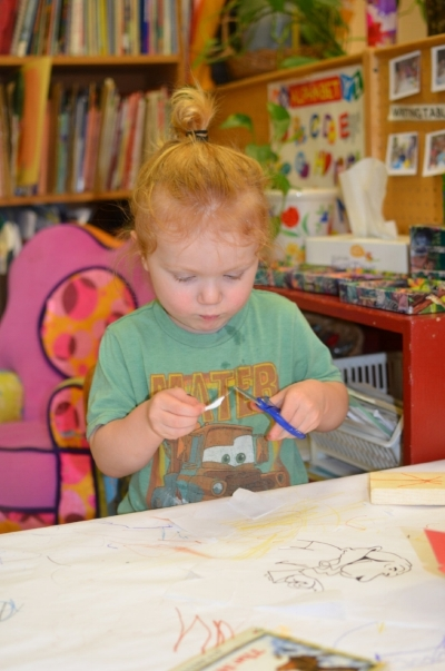 Crayons, markers, safe scissors, glue and paintbrushes are all great tools for mastering fine motor skills and hand eye coordination. And children love to talk about their artwork--it gives them practice with langauge and self expression.