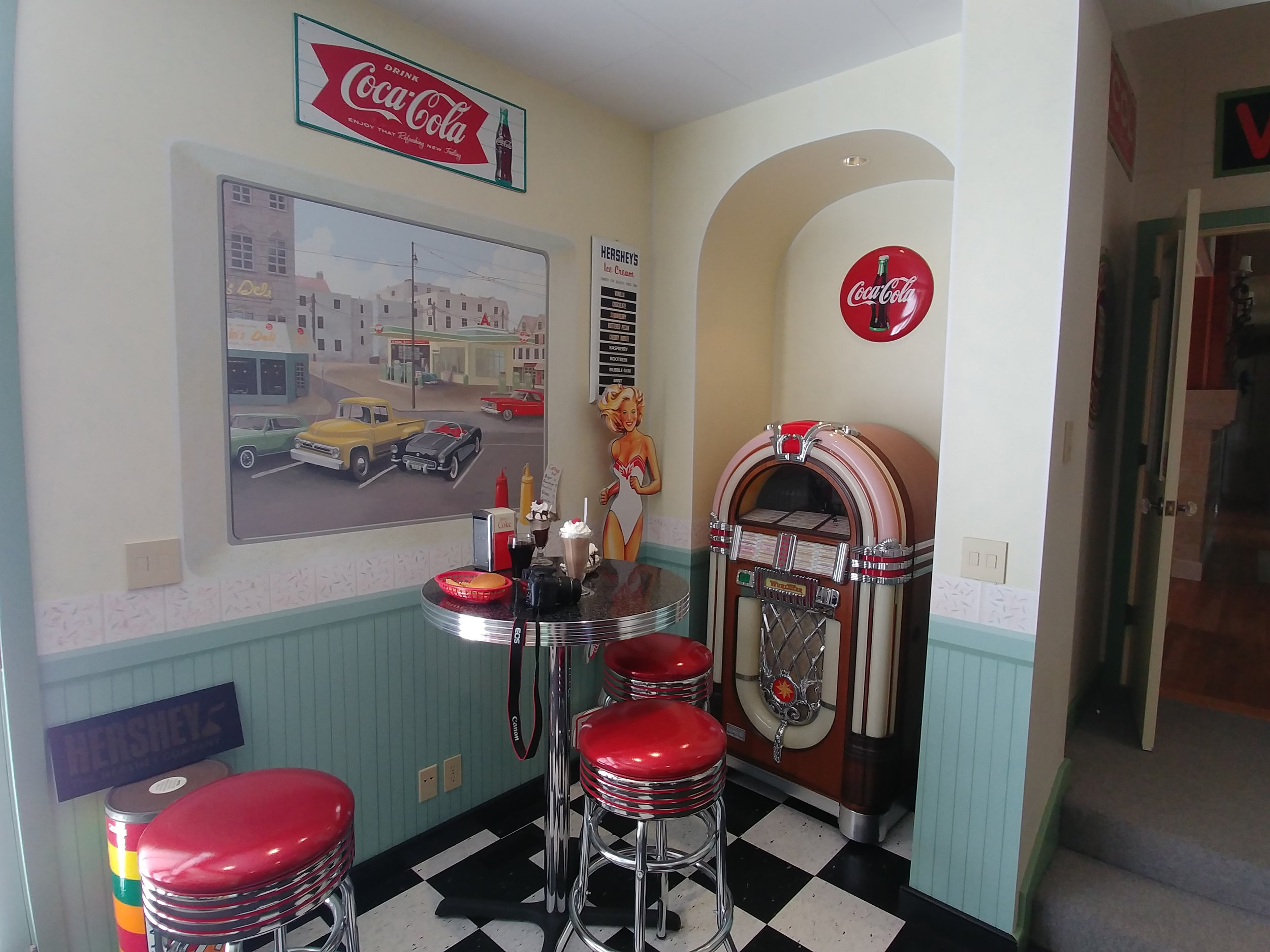 This little diner has many hand painted touches including the window mural, tile and wainscoting.