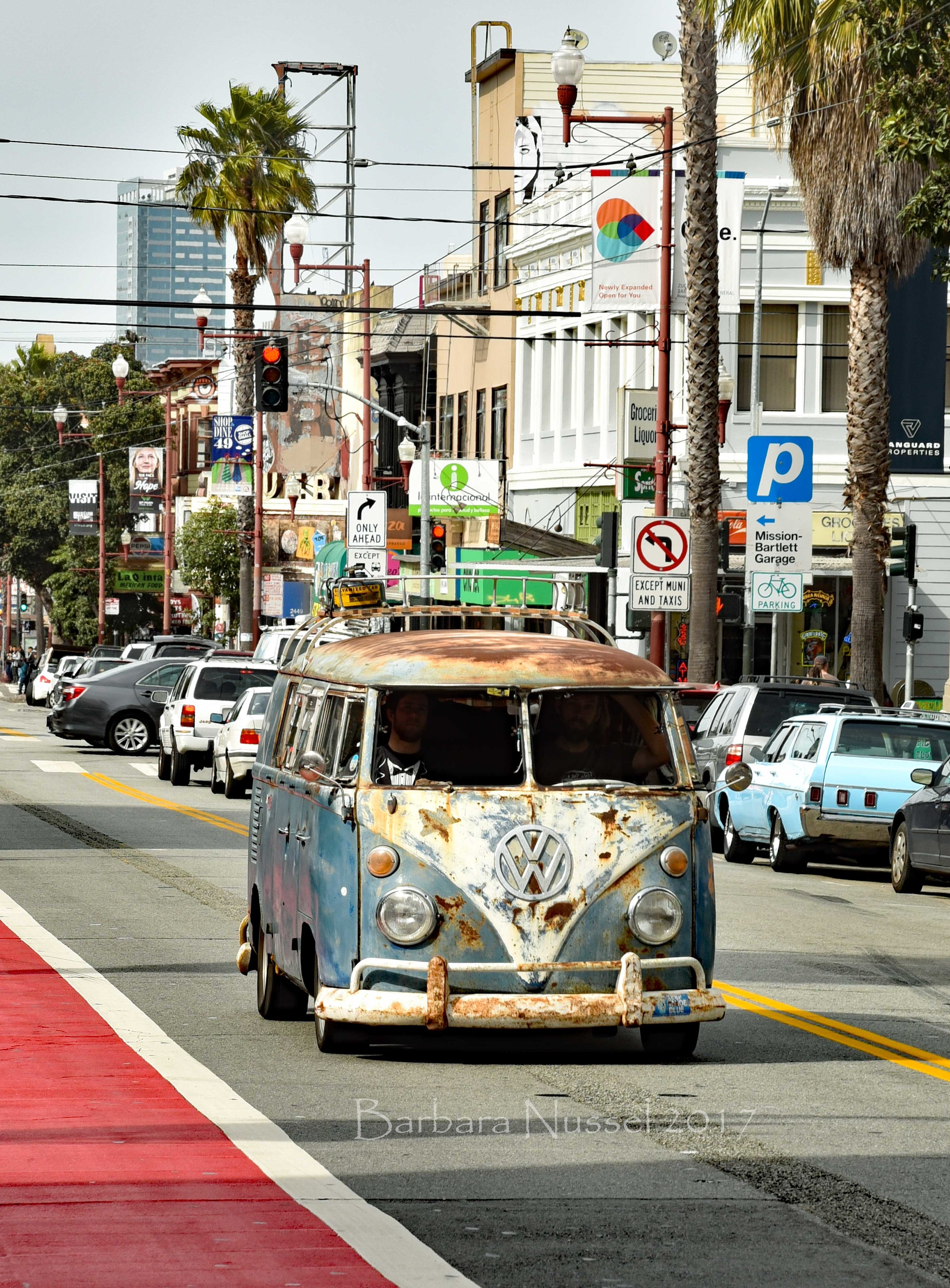 A very vintage VW bus rolling down Mission Street