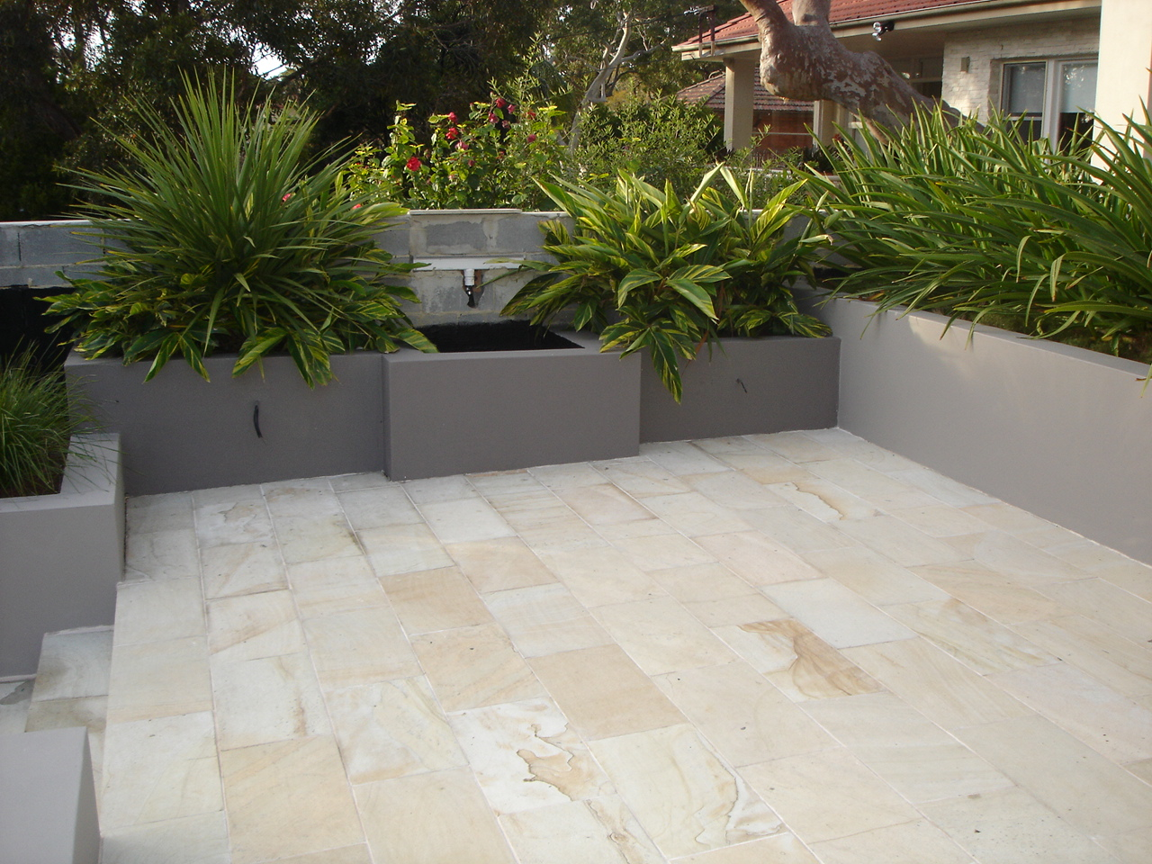 Explore our large database of internationally sourced stone.  Sandstone, Granite, Marble, Limestone, Travertine etc.  Palimo Sandstone Tile features in this Sydney project..