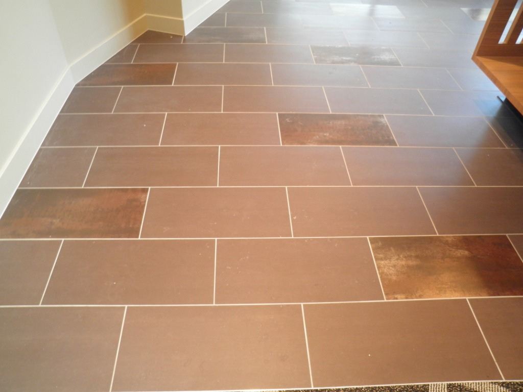 Coffee Matt and Copper Feature porcelian tiles to entry flooring.JPG