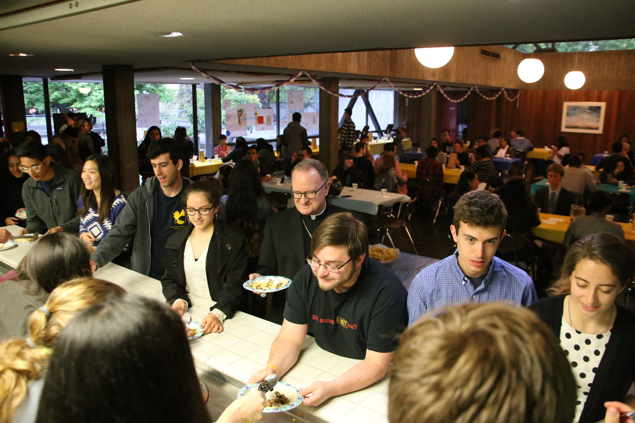 Bishop Barber at Student Dinner food line.jpg