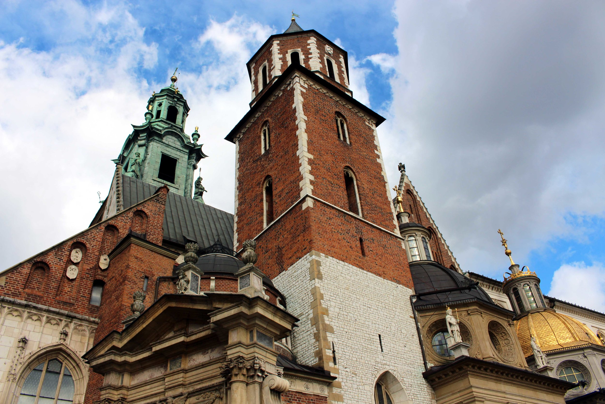 Though I was there for less than a day, I got a month's worth of walking done in Kraków ,  seeing sites like this one, the Wawel Royal Castle.