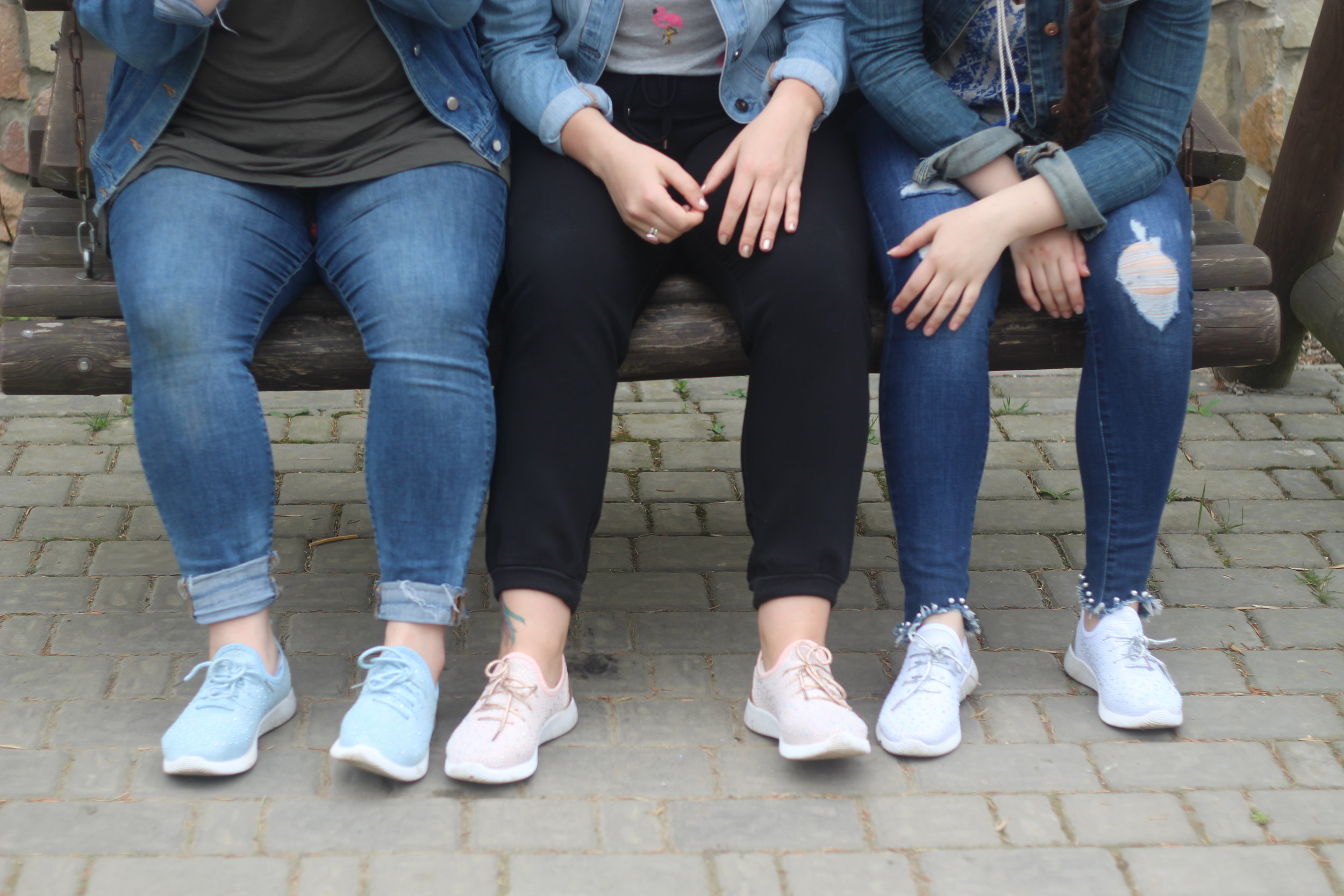Do Hannah, Kaitlyn, and Natalya have matching sparkly market shoes? Of course they do.