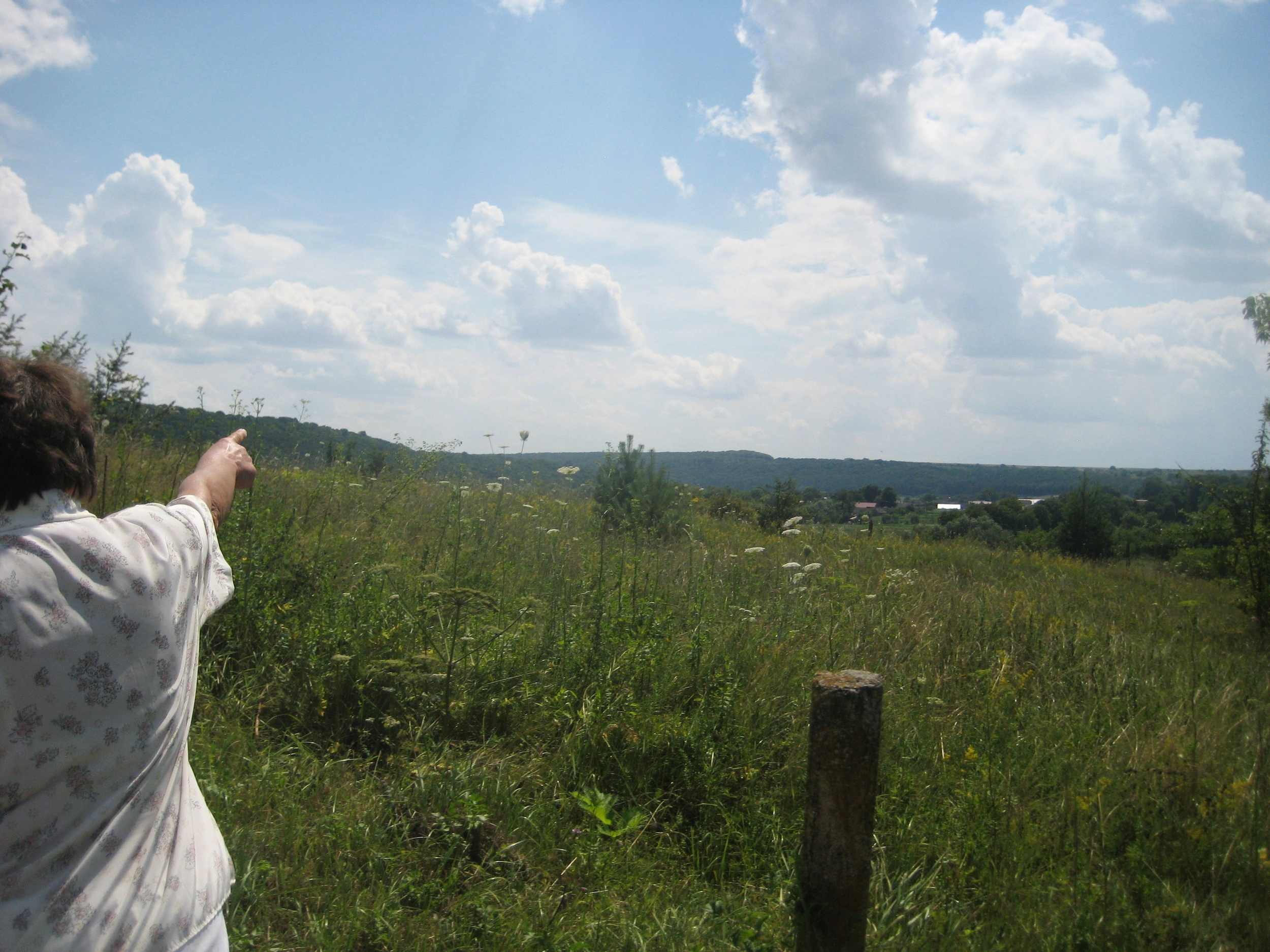 Hanna, in 2014, pointing to the recycling plant near the village.