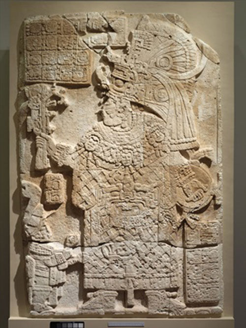 The queen known as Lady K'abel from El Peru Mayan city is shown in ceremonial headdress on Waka Stela 34. Note also the battle shield in her hand.