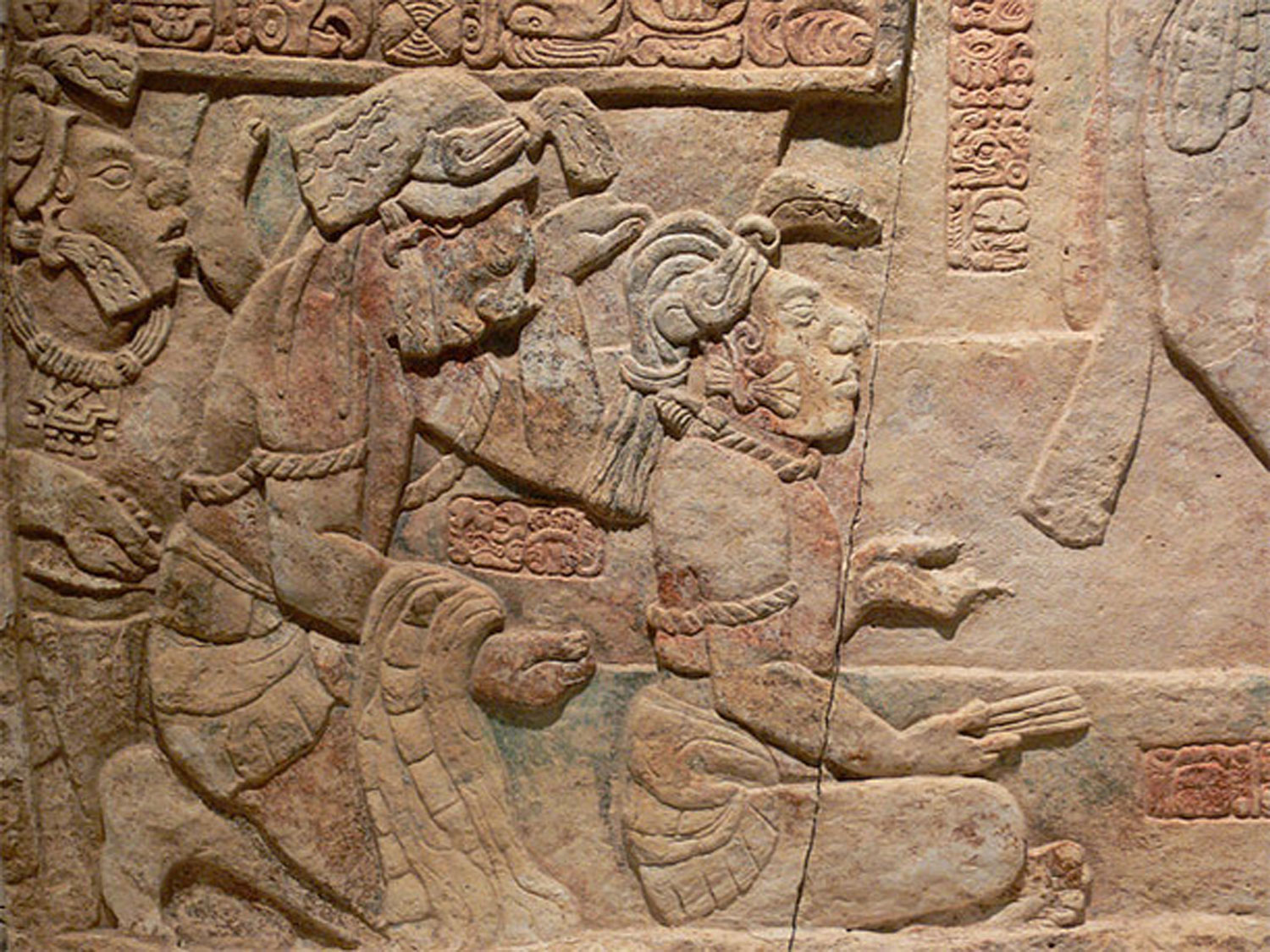 Three captives are being presented to the king Itamnaaj Balam III of Yaxchilán (769-800 AD), with paper slips in their ears.