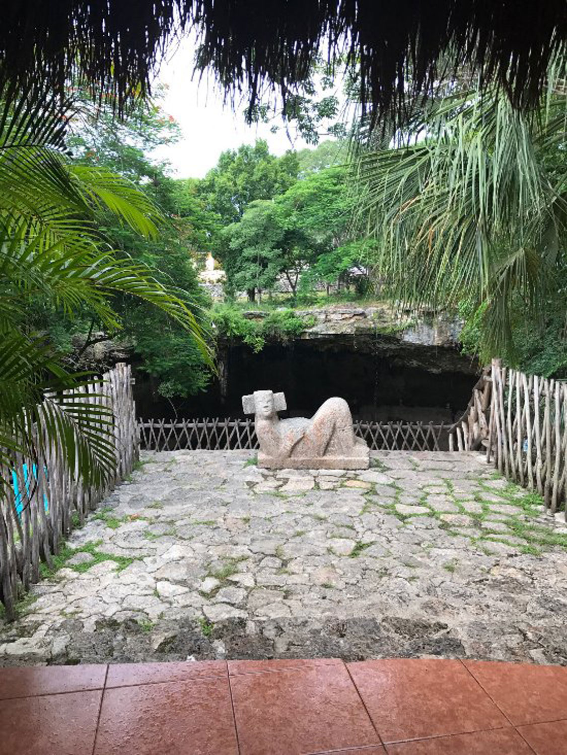 Chacmool guards the cenote. Right: Valladolid's coat of arms, Zací (white hawk).