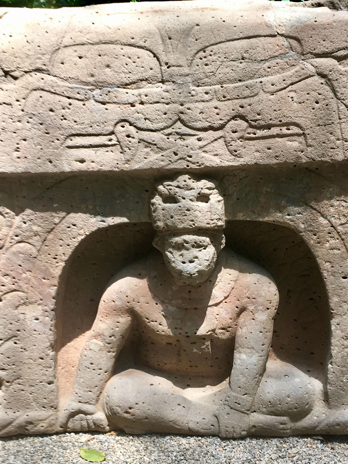 Altar 4, La Venta Olmec park museum. Two heads of serpents face each other above a man emerging from a cave.