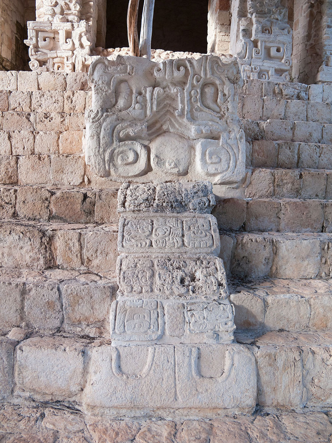 Head of serpent at the Acropolis staircase in Ek' Balam. Hieroglyphs on the snake's tongue indicate that the staircase was dedicated as a war memorial.