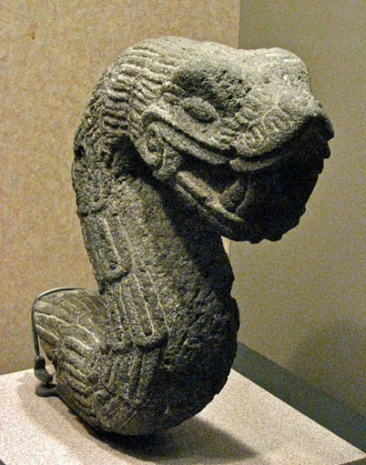 Aztec stone sculpture of a feathered serpent at the National Museum of Anthropology, Mexico City