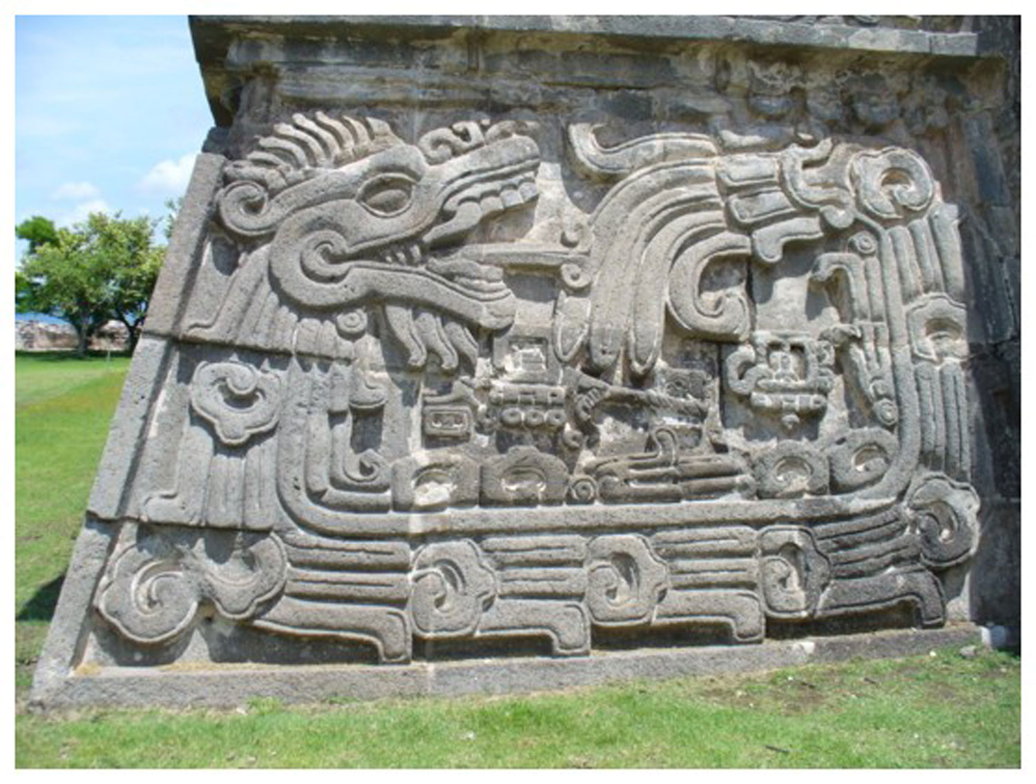 The serpent eating its own tail, possibly representing the recreation of life through death? The temple of the Feathered Serpent, Xochicalco. Credit: Pinterest.