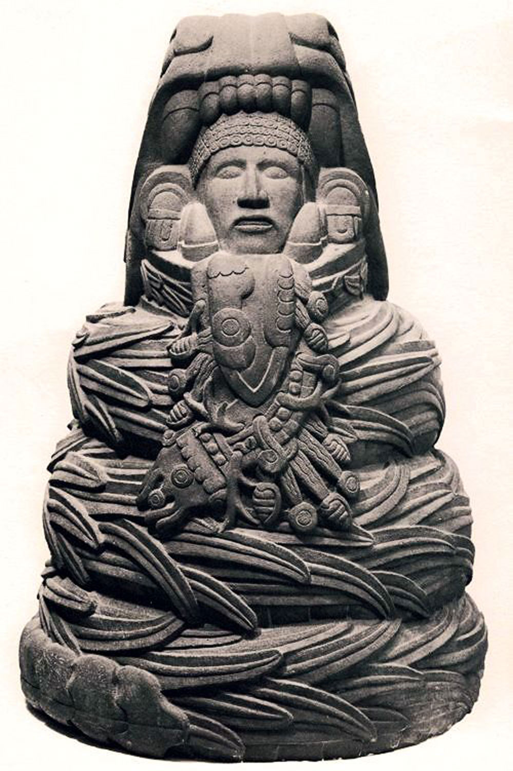 Quetzalcóatl seated in the coil of a snake, Tula. Right: Kukulkán at   Chichén Itzá   .Credit: Pinterest.