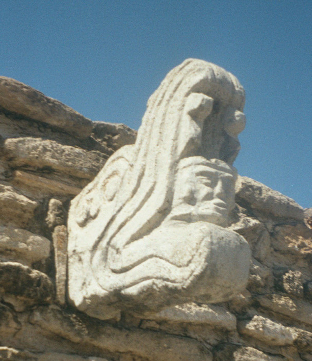 Mixco Viejo  in Guatemala: a person emerging from serpent's jaw symbolised the birth of gods and kings. Credit: Pinterest