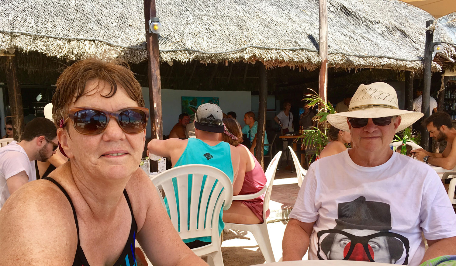 With my friends Chris and John at Lol-Ha restaurant on the main beach. Right: Restaurante La Buena Vida.