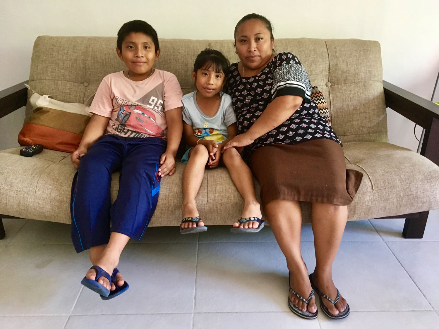Lupita and two of her children. Right: Maria's house in Cobá.