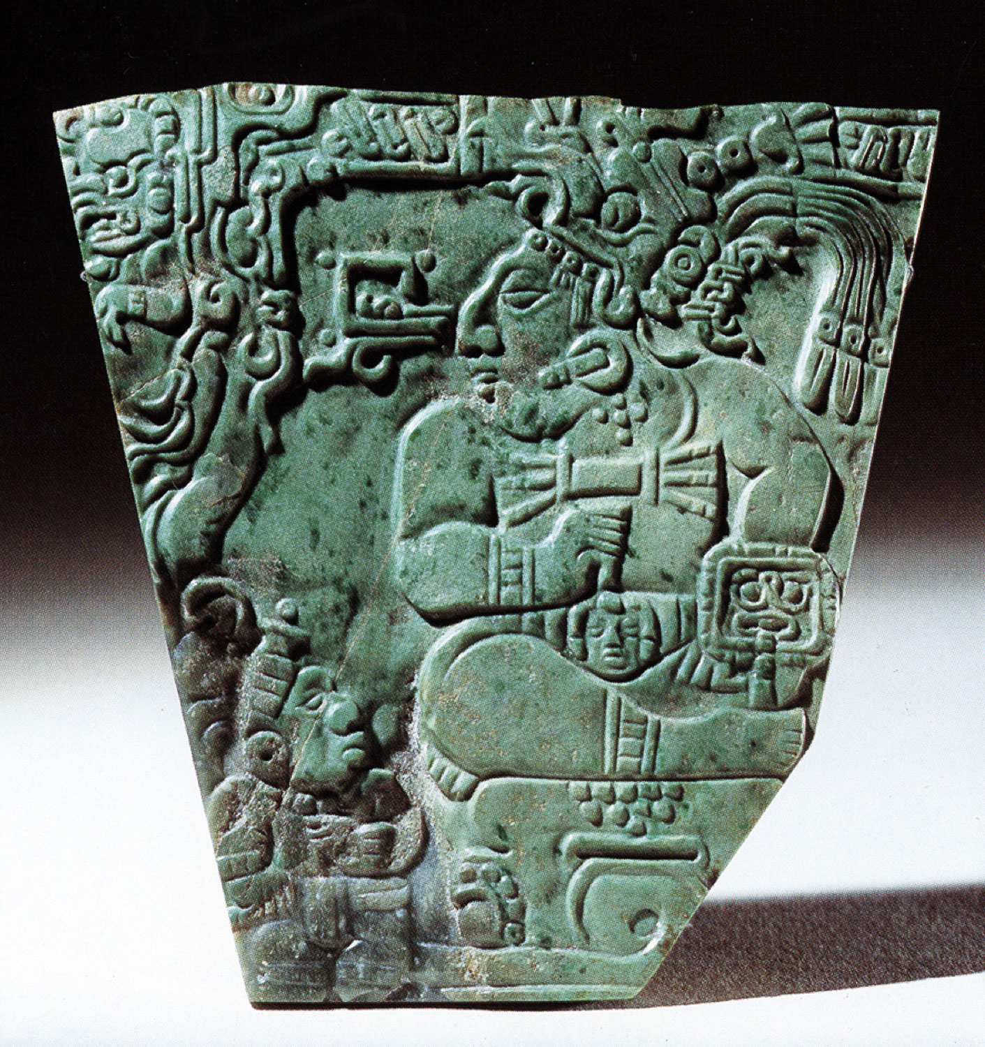 Jade plaque of ruler attended by court dwarf.Source:  mexicolore.co.uk . Now in the British Museum.