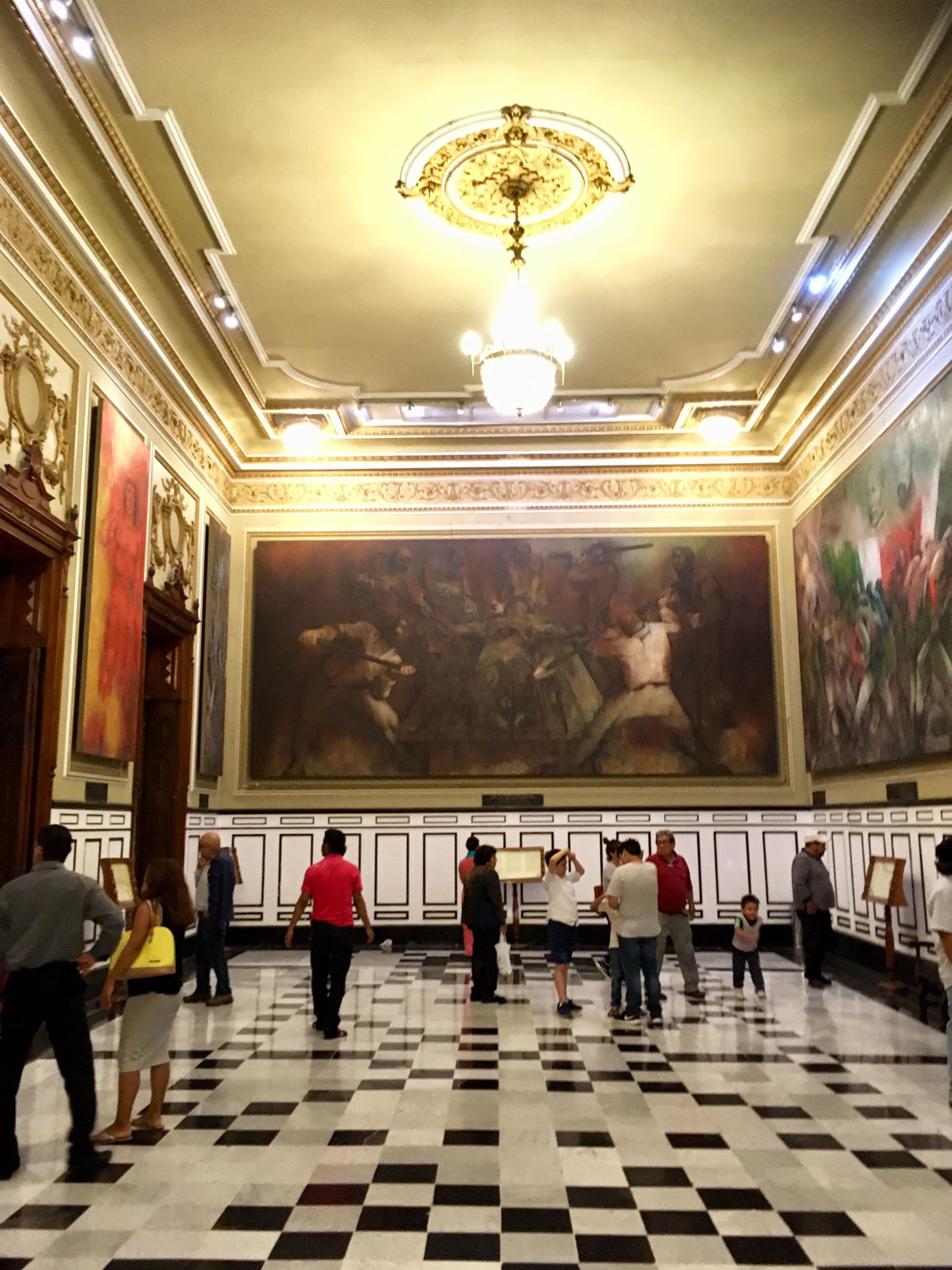 The murals in the Town Hall.