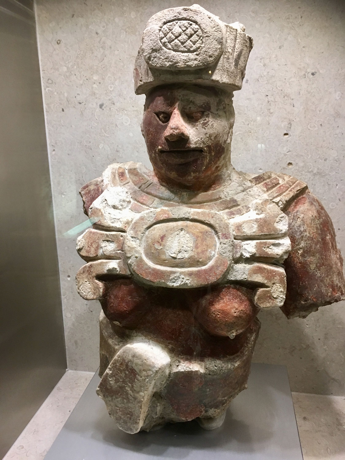 A figure with paint (600-900 AD). Does the colour help you to guess the identity? What about the breasts? Is this a female? Note the squinted eyes (very fashionable for the Mayan nobles), headdress and a large necklace.