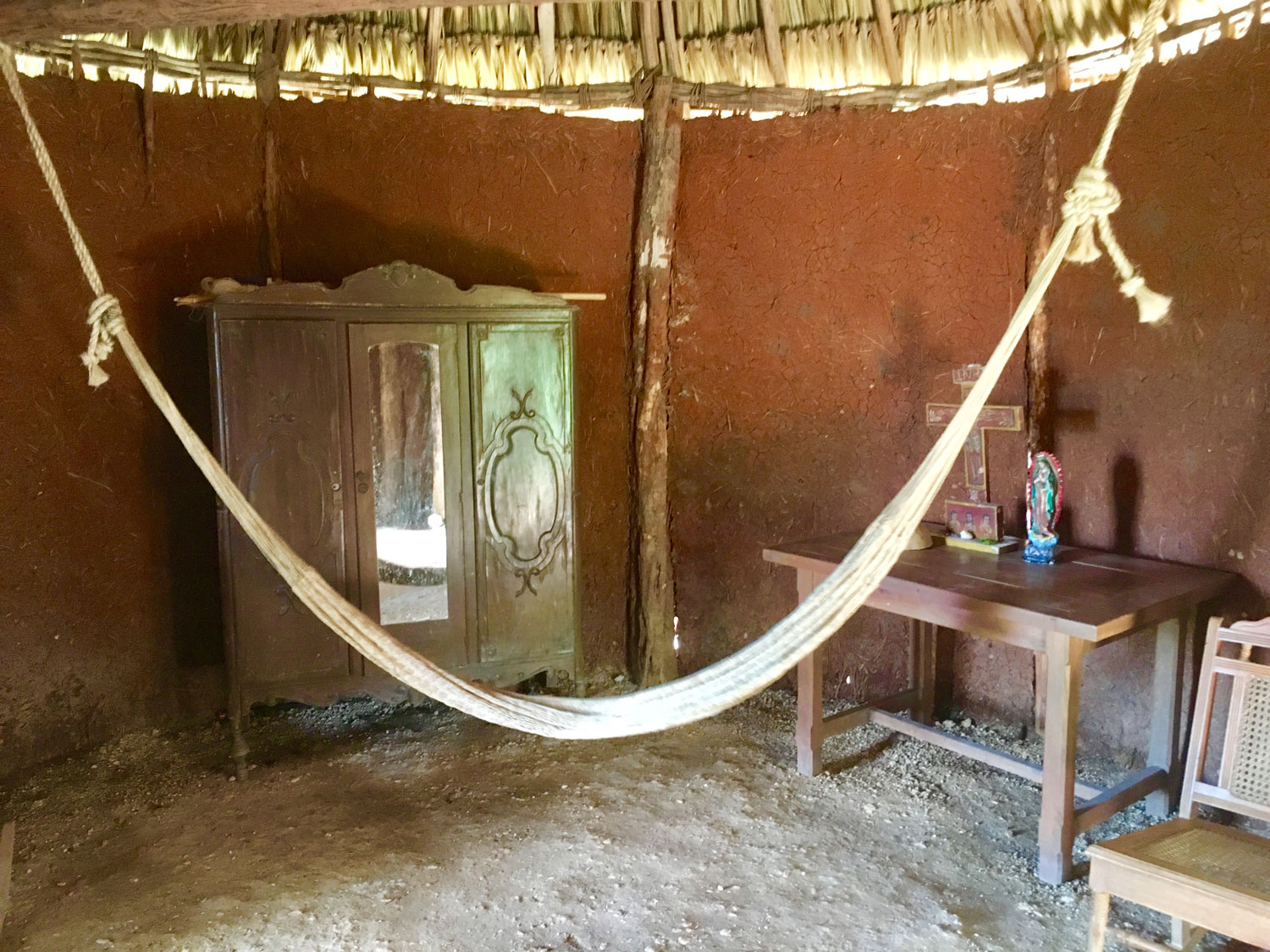 Traditional Mayan wooden house, with a palapa roof (from palm leaves). Below: with Don Antonio whose parents worked here.