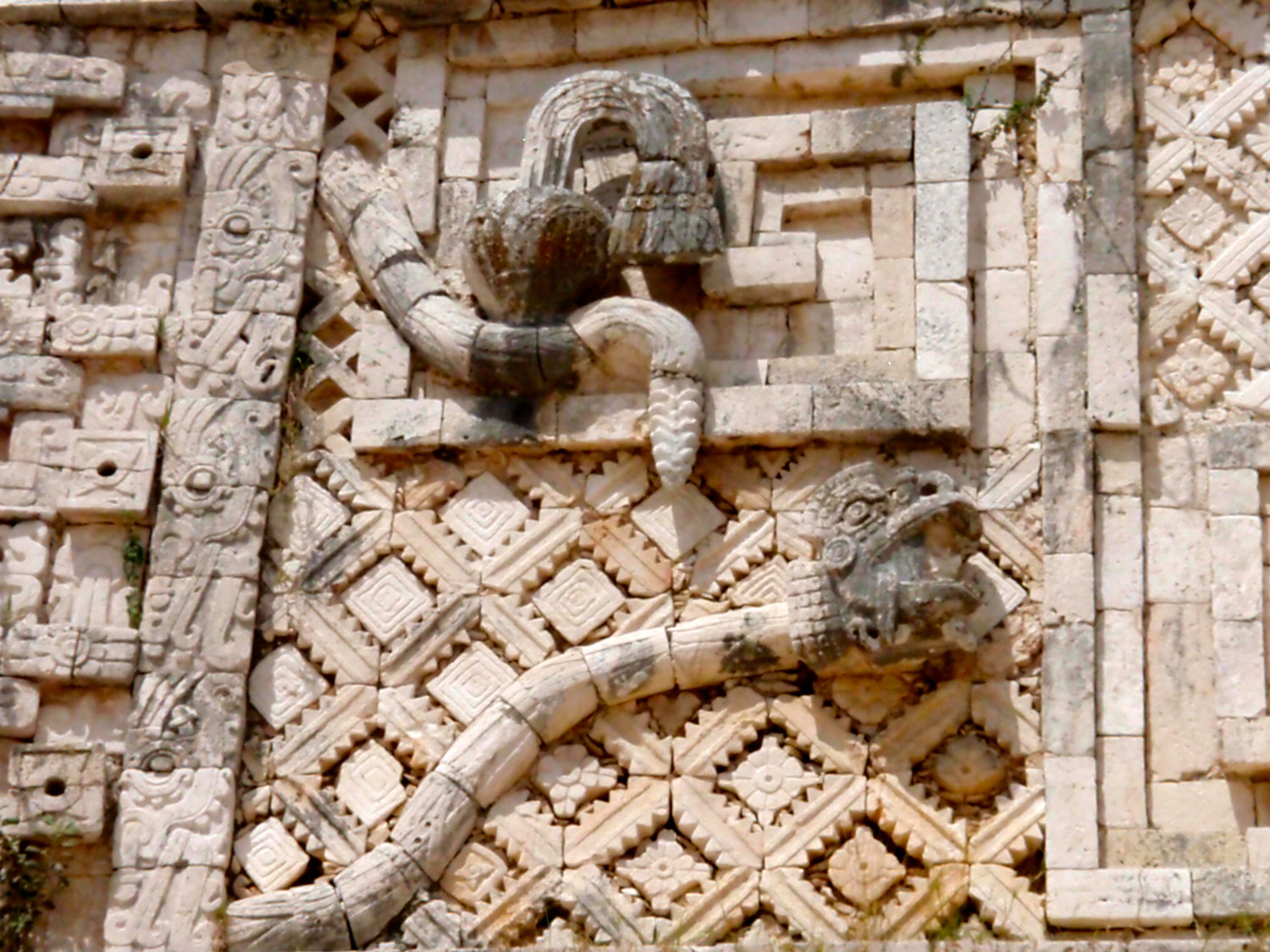 Serpents on the Nunnery building at Uxmal,among the sculptures of a god, a king and a priest; a conduit for their passing to the heavens.