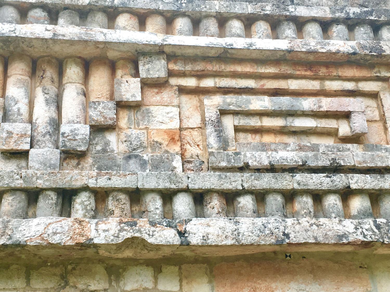 Columns and spiral geometrical motif, called step-fret (G-shape).