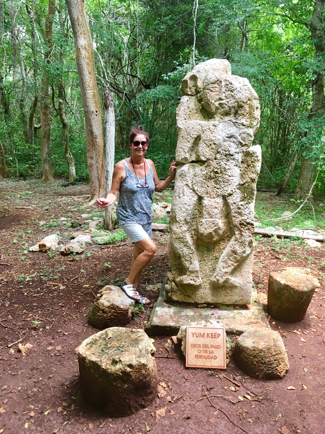 Posing with the god of fertility, Yum Keep, at the nearby ruins of Sayil.