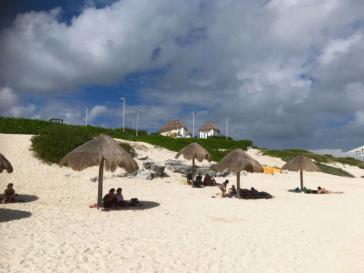 The palapas (made from palm leaves) on the beach are free.