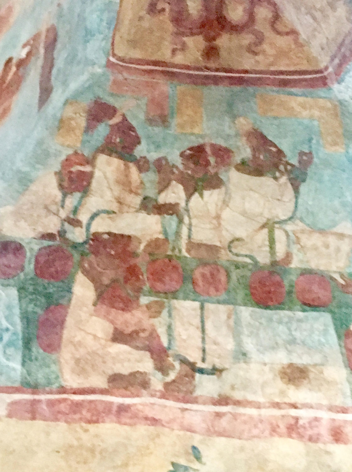 The noblewomen (king's wives?) cutting their tongues with stingray spines in a bloodletting ritual, to celebrate the war victory.