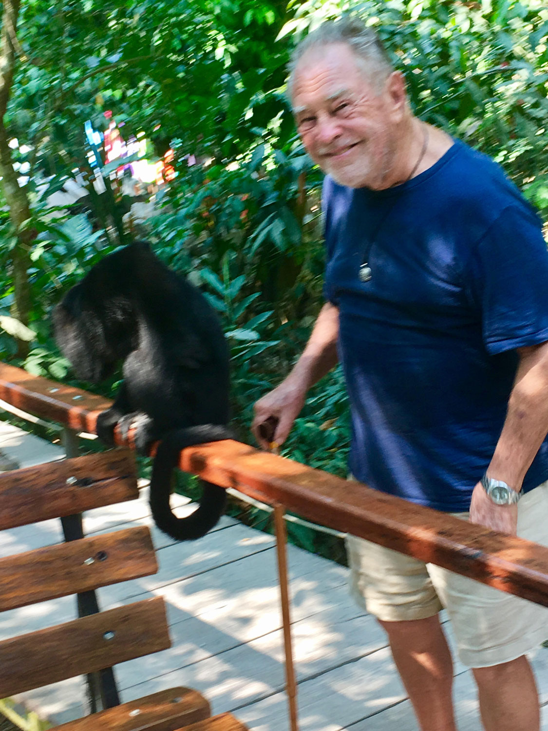 Our friend John with a monkey at El Panchán restaurant. 2017.