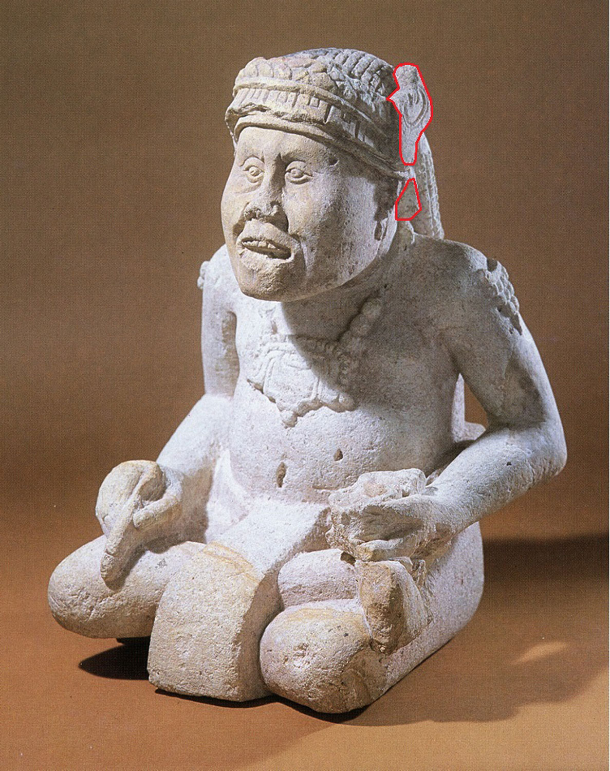 Monkey-man scribe from Copán. He holds a brush and an inkwell. Note the 'deer' ear. Source:  latinamericanstudies.org .