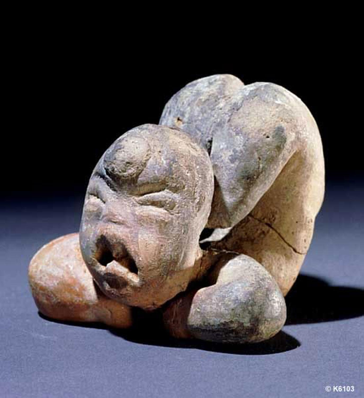 Olmec Acrobat from Las Bocas:  research.mayavase.com .
