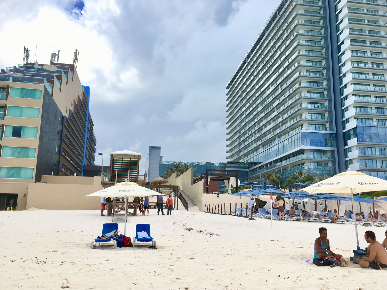 Our beach chairs, lifeguards and the Secrets hotel on the right.