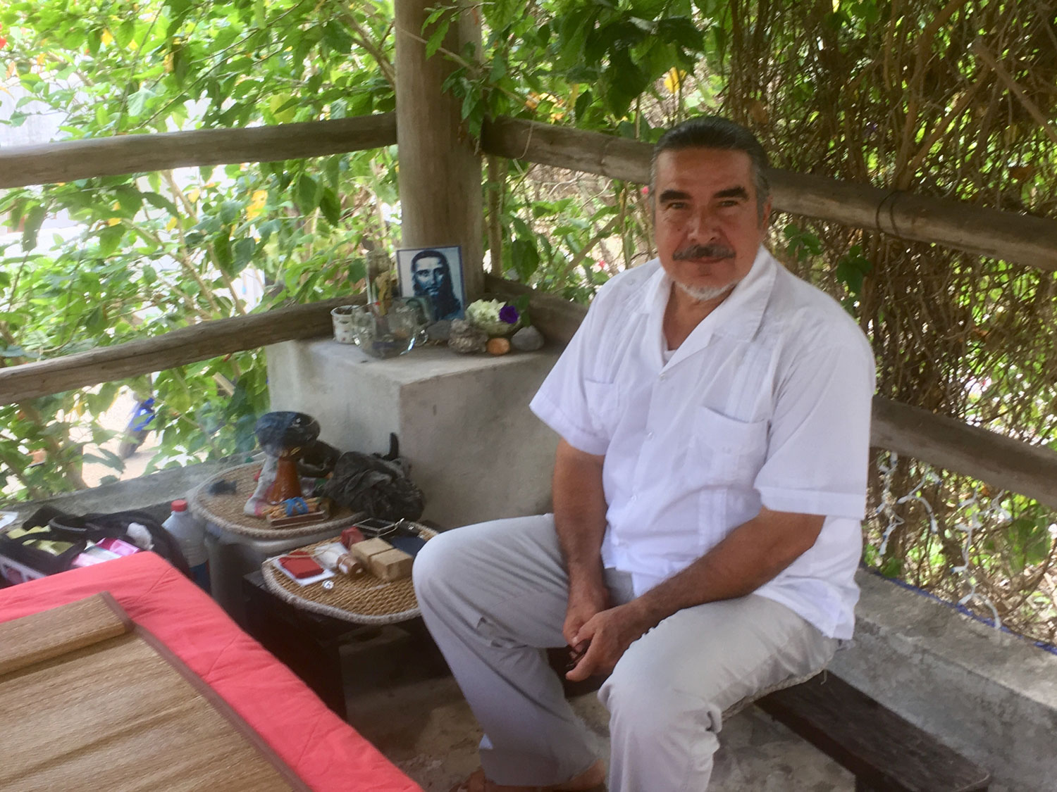 Jesus Eduardo, Ah Men from Cozumel, ready for our session. Note his altar, a mixture of Christian and Maya items.