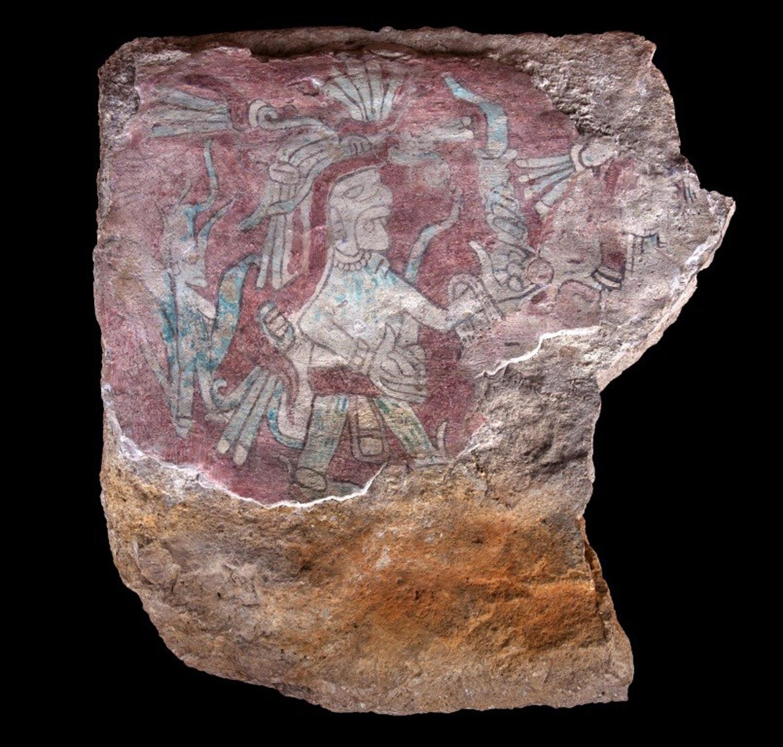 God Izamná on a stone fragment. Now at Museo Maya de Cancún.